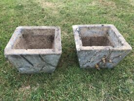 A Pair Of Stone Planters