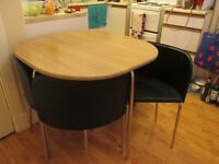 Table and chairs, lightly used, compact storage as chairs slot underneath table when not in use