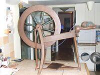 spinning wheel with bobbins and alpaca fleece