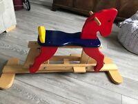 Wooden gliding rocking horse