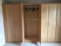 Free and already dismantled ready for collection.Wardrobes,light wood effect with chrome handles