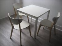 White laminate kitchen table and 3 chairs good condition from non smoking house