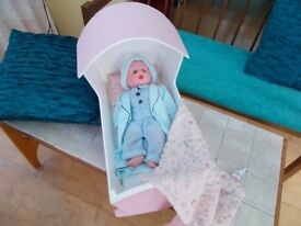 Cradle with doll wearing night wear. Also bedding included.
