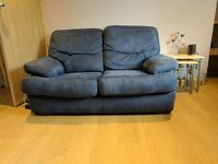 2 x 2 seater blue fabric sofas and matching foot stool