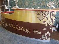 Large reception desk in beech-sticker detail can be easily removed