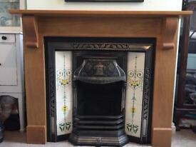 Cast iron tiled Victorian fireplace with solid oak surround