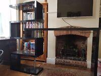 Black gloss shelf unit and breakfast bar cost 175 on ebay less than a year ago.