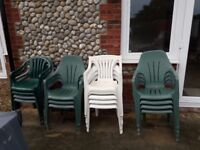 5 white and 13 plastic garden chairs