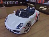 PORCHE KIDS ELECTRIC RIDE ON CAR BRAND NEW WITH RECEIPT