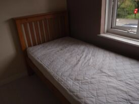 Pine 3ft single bed. with mattress - used only as guest bed.