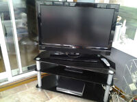 32 inch LG hd lcd television and black glass 3 shelf stand
