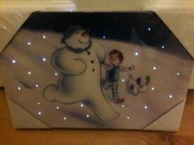The snowman and the snow dog LED Wall Art