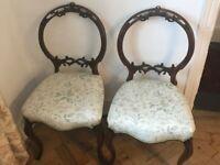 2 matching mahogany oval back chairs