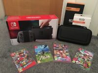 Nintendo Switch- Like brand new- Includes 4 games, carry case and screen protector