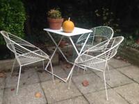 White wrought iron garden chairs