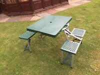Camping table with integrated chairs