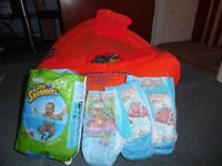 Zoggs swimming trainer seat 12-18 months with 20 swim nappies