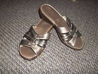 Brown/bronze sandals. Leather upper and wider fit. Size 6.