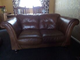 2 x two seated ,tan coloured, genuine leather sofas