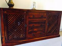 Solid dark wood sideboard with cabinet/drawers