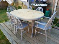 Solid pine 6 seater dining room table and chairs