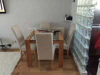 Brand New Dining set for 4 ( glass dining table plus 4 chairs)