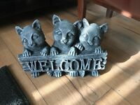 Stone garden ornament of a cat welcome