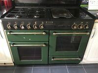 Cooker oven with hood