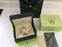 Rolex Sky dweller gold watch.