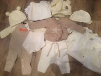 Bundle of neutral new born clothes