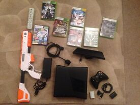 Xbox 360 Kinect & 7 game with remote and gun.