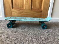 Blue skate board with blue wheels