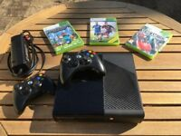 Xbox 360 with one wired controller and one wireless. Plus 3 games.