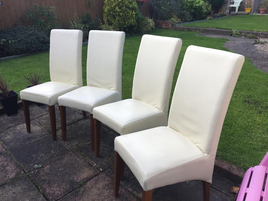 5 cream leather chairs.