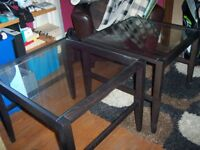 2 dark wood and glass side tables