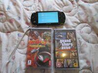 PSP 1003 HANDHELD + 2 GAMES