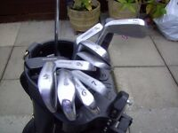 full set of clubs in bag and with trolly