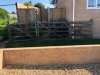 Wooden driveway, field, garden gate with pedestrian access