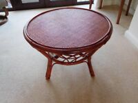 Round Coffee Table in wicker/rattan. 65cm w x 46cm h. Use inside or outside. VGC (Can be painted)