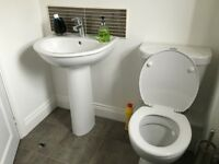 White standard bathroom suite