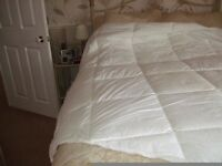 A microdown fibre duvet with a left hand cutout for a right hand side caravan bed