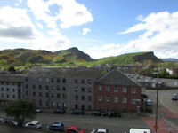 Central, Abbeyhill. One bedroomed top flat with fantastic southerly views to Arthus's Seat