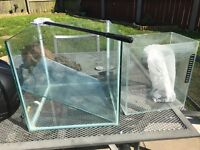 1 cube fish tank with lid and light and little fry tank good condition