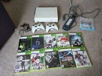 Xbox 360 bundle with 10 games and 2 controllers, includes HALO 4, COD black ops 2, Alien Isolation