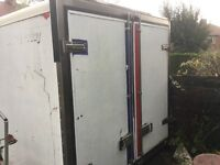 INSULATED EX FRIDGE VAN DOORS WITH STAINLESS STEEL FRAME AND HINGES AND LOCKING MECHANISM.
