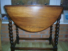 Small drop leaf table with barley twist legs. Good condition.