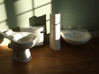 White sink taps pedestal and waste toilet and cistern