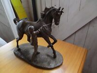 Gorgeous horse and stable girl sculpture.
