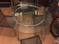 IKEA glass table with four chairs