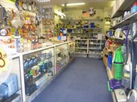 Used shop display counters cabinets with shelves and lights situated in southend